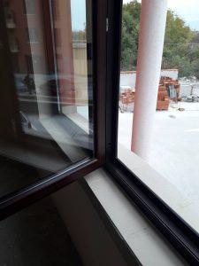 Основно почистена дограма при отворен прозорец - след ново строителство.