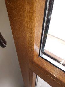 Почистена дограма и стъкла на врата на тераса.